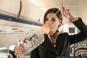 Air stewardess performing safety demonstration on aeroplane